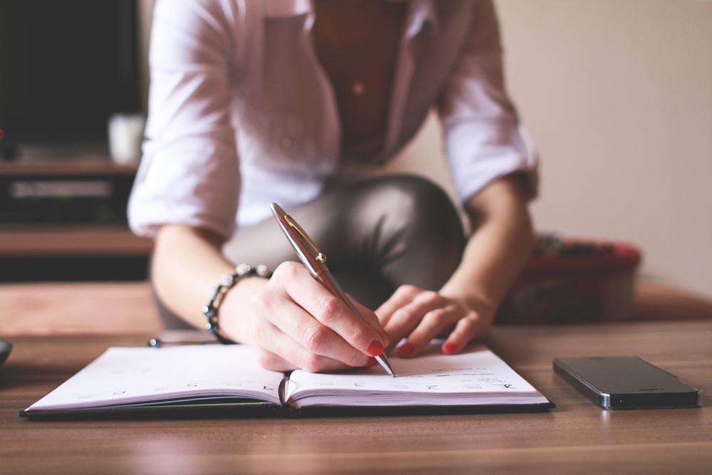 girl-writing-in-a-diary-picjumbo-com